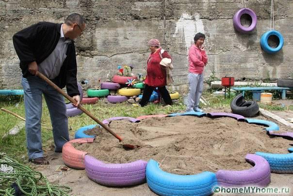Устройство песочницы из покрышек