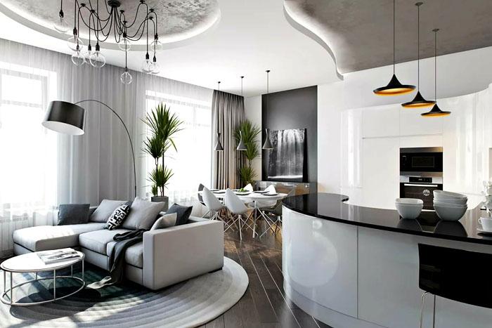 Тёмные черты мебели в совмещённых комнатах гармонируют с деревянным полом