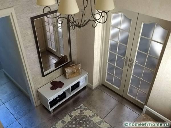 Без выделения отдельного пространства для прихожей может получиться интересный дизайн