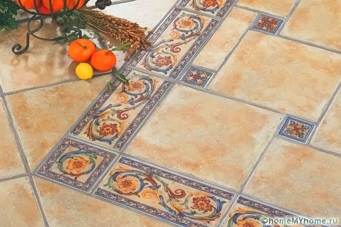 При оформлении кухни в стиле прованс используется плитка маленького размера и с растительными орнаментами