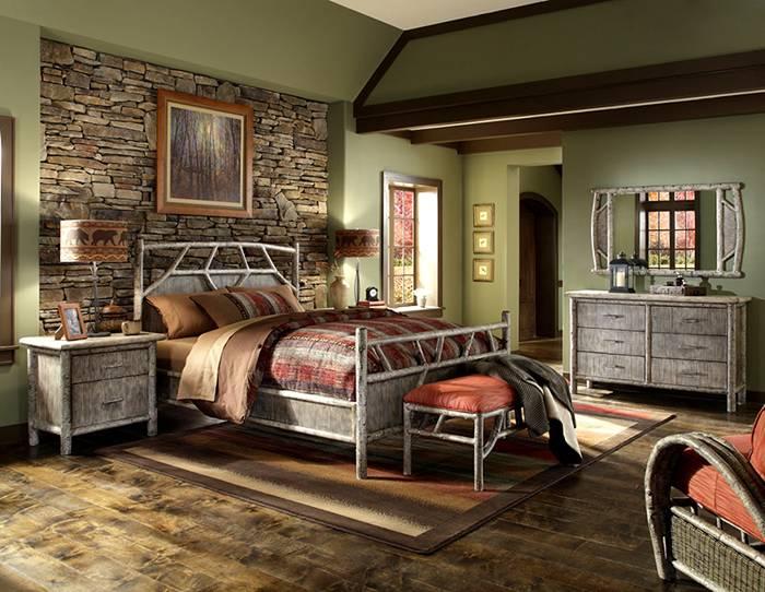 Даже серые оттенки в оформлении не отменяют общую атмосферу уюта в спальне