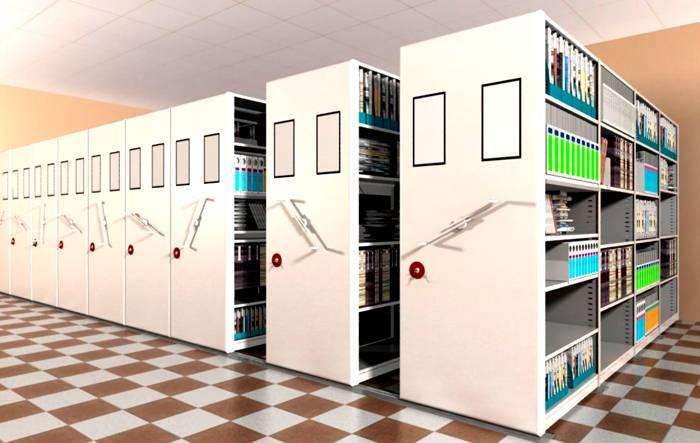 Тяжелые стеллажи архивные металлические сборные оснащают специальными механизмами, которые облегчают перемещение