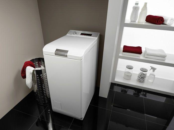 Крышка, открываемая вверх, не позволяет встроить стиральную машину в каркас мебели, установленной в помещении