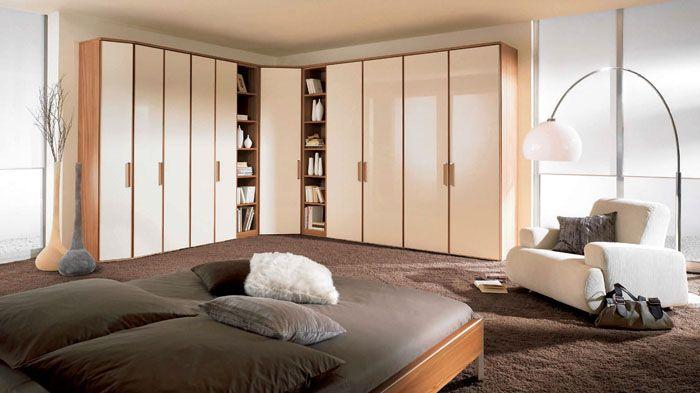 На фото показан модульный угловой шкаф в спальню, цена которого не станет большой нагрузкой для семейного бюджета