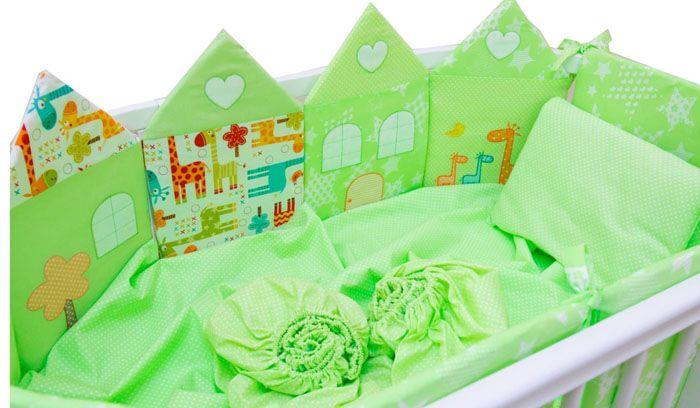 Для овальных кроваток хорошо подходят борта в виде подушечек без большого объёма