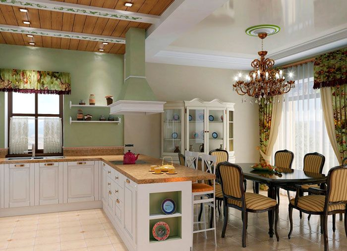Здесь для визуального разделения общего пространства кухни/столовой применено различное оформление частей потолка