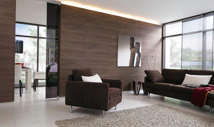 Выразительный, но экономичный дизайн зала в квартире. Вместо дорогого натурального массива, для отделки стен можно использовать демократичный по цене ламинат