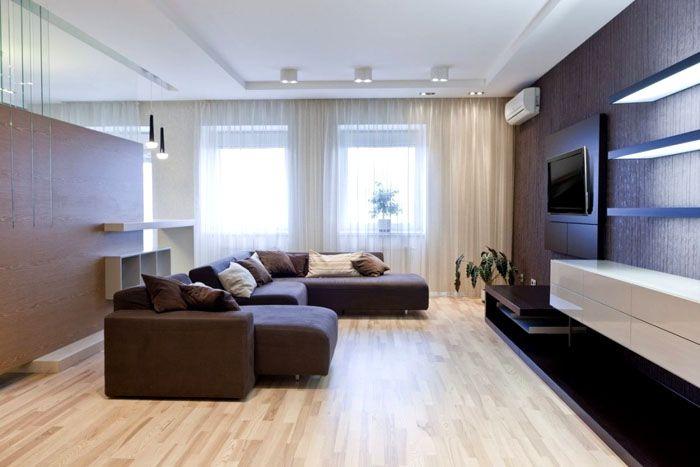 Практичность минимализма. Одно из явных преимуществ такого дизайна зала в квартире – простой уход