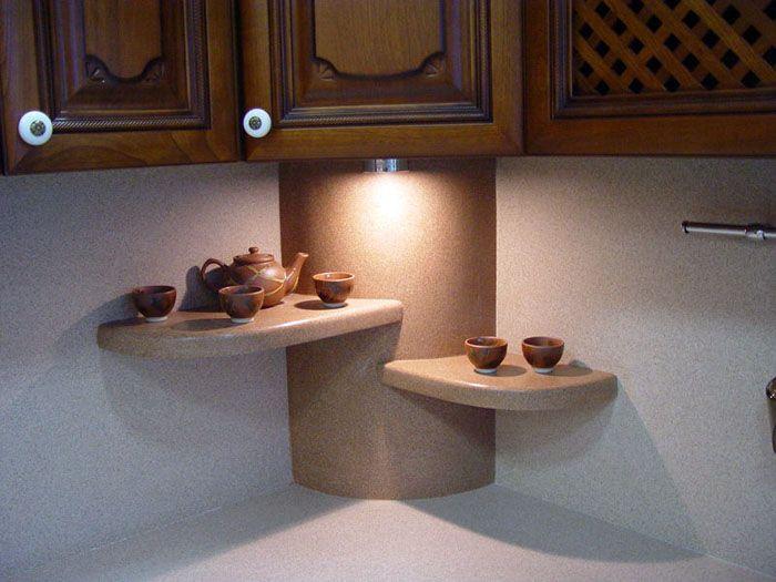 Искусственный камень используется больше в декоративных целях, для формирования определённого облика кухонного пространства