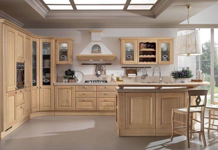 На фото дизайн кухни в бежевом цвете