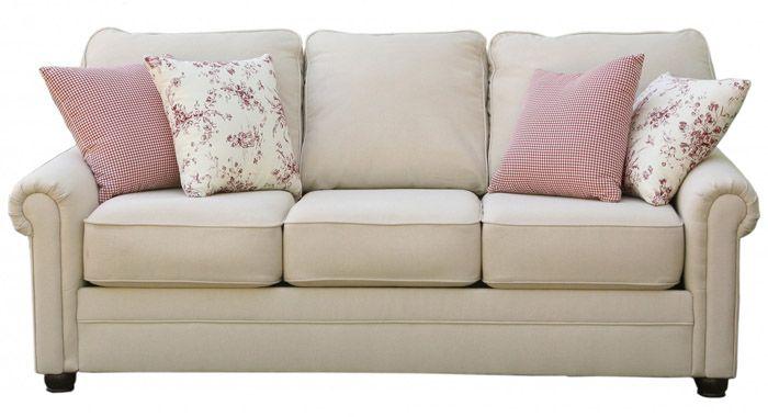 Однотонная мебель нейтральных тонов обязательно дополняется обилием текстиля