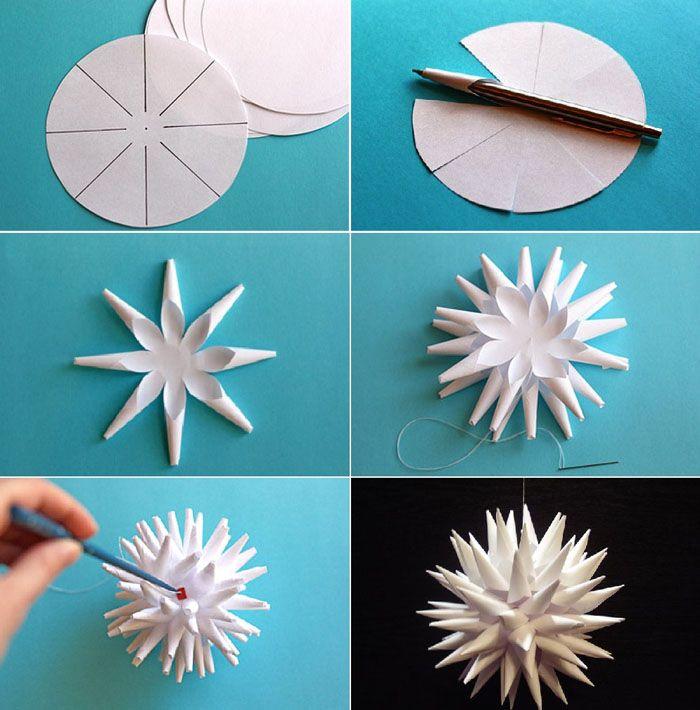 Понадобится несколько одинаковых по размеру кругов, расчерченных как на фото, ножницы, клей и нитка. Если сделать с каждым элементом то же самое, что и с шаблоном, получается много интересных звезд, которые с помощью клея соединяются в пушистый шар. Не забываем в момент приклеивания последнего элемента прикрепить туда же нитку для подвязывания игрушки