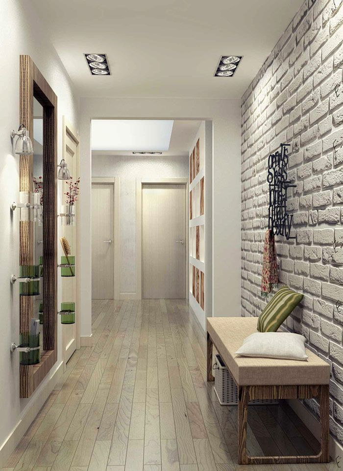 Светлый декоративный кирпич визуально делает узкий коридор шире. Минимум вещей обязателен
