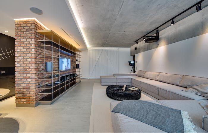Хорошо отыграет свою роль навесной уровень потолка с подсветкой, выступающий контрастом для фактически необработанного потолка от этажного перекрытия