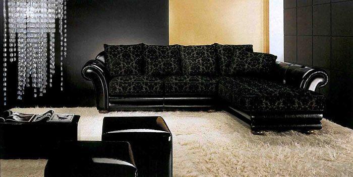 Темная кожа с почти черной обивкой создает в гостиной ореол элегантности
