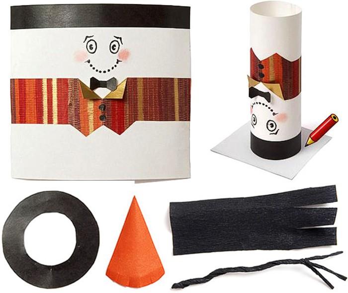 На листе бумаги рисуем вечерний костюм для снежного гостя и склеиваем его