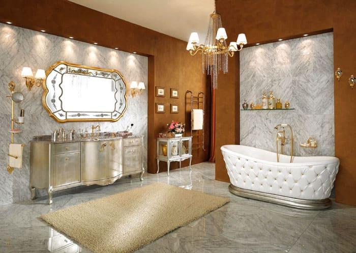 Мраморная отделка на фотоотлично сочетается с плавными очертаниями мебели. Ванна смотрится необычно и её внешние стенки напоминают обивку изголовья кровати