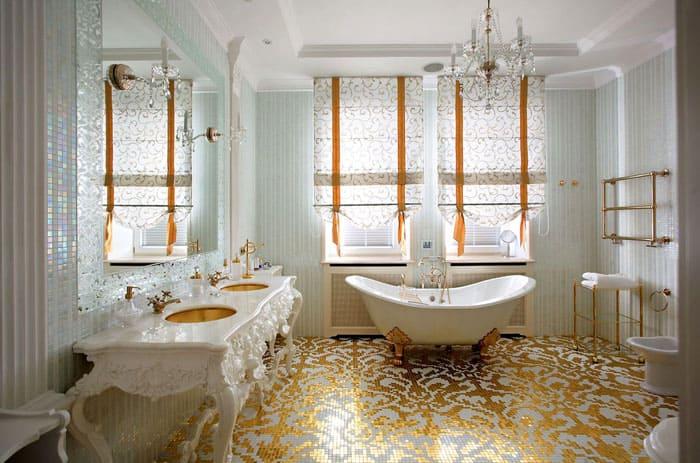 Привнесение современности совершенно не портит ванную. Позолота перемещается на пол, а мебель с её художественными резными элементами прекрасна и в исполнении белого цвета