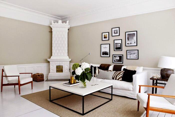 В современный интерьер можно вписать печь-камин, сделав её подходящей частью облика гостиной