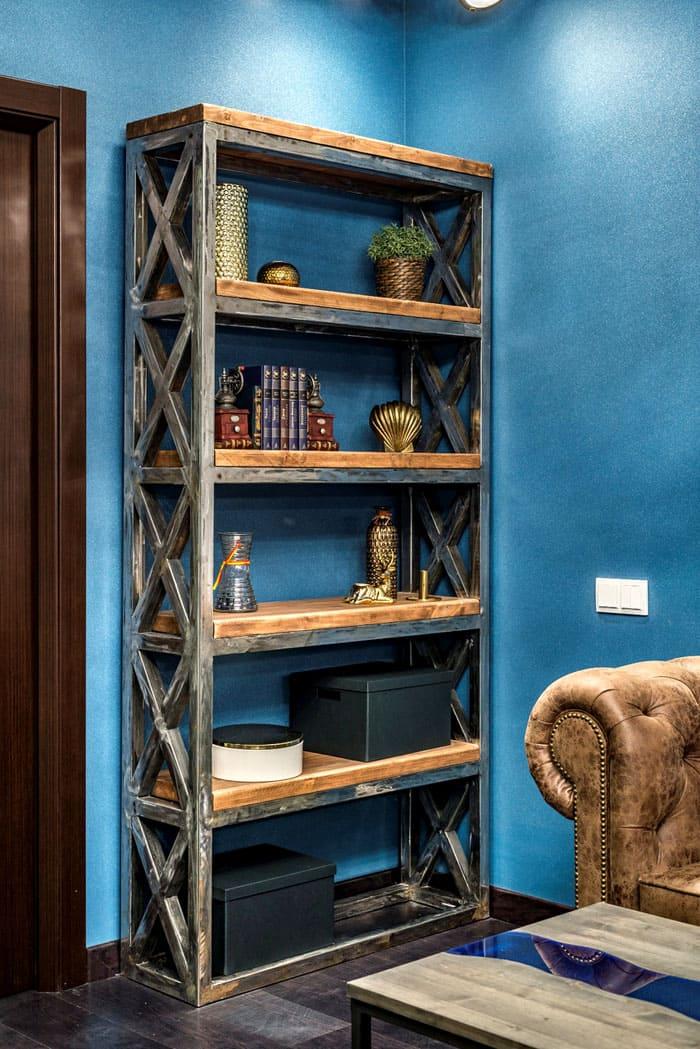Стеллажи могут послужить библиотекой, местом хранения бумаг и прочих вещей. Деревянное исполнение тоже подходит под лофтовую отделку