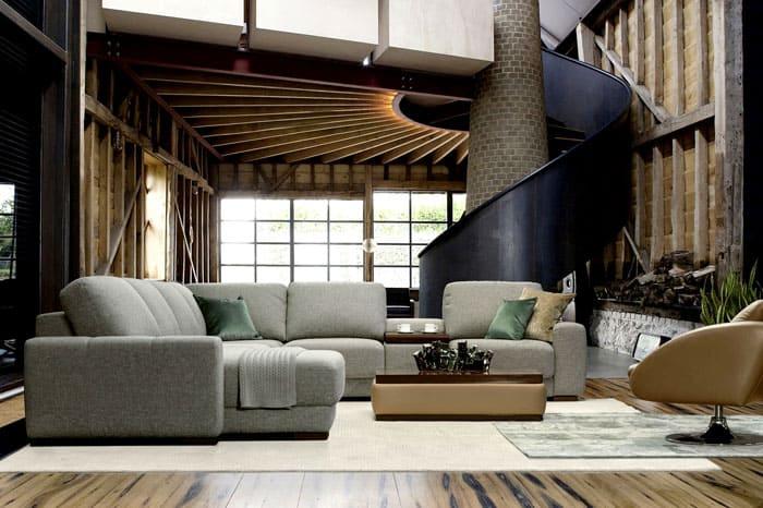 Конечно, истинный loft невозможен без высоченных потолков и обилия естественного света из громадных окон. Мебель не выделяется, а плавно вписывается в обстановку