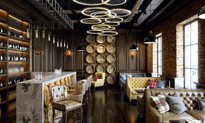 Декор в виде крышек от настоящих бочек, удобная мебель под кожу, журнальные столики: это практически домашняя расслабляющая обстановка!