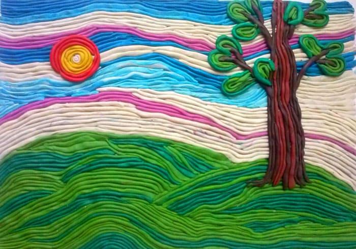 Из таких вермишелек «рисуют» красивые пейзажи. Необязательно искать пластилин с большим количеством цветов, оттенки получаются путём смешивания исходных кусочков между собой