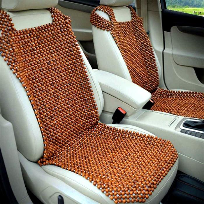 Автомобилисты сделают себе подарок, если расположат на спинке своего сиденья такой массажёр