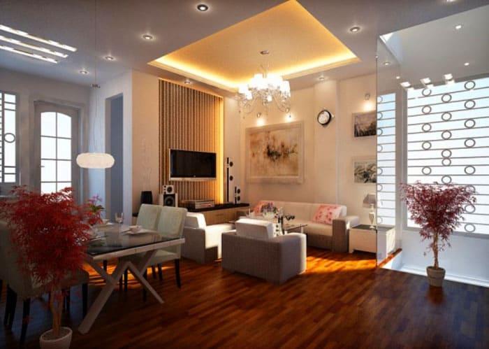 Центральное место можно выделить подсветкой по уровню потолка