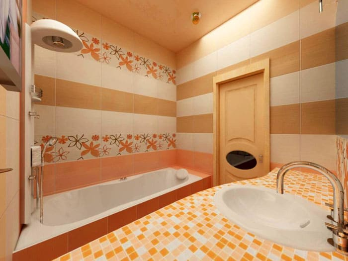 Сочетание плитки и мозаики в кремовых, пастельных, персиковых тонах делает облик ванной нежным